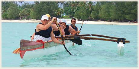 paddlers after race in typical polynesian outrigger canoe on Muri Lagoon